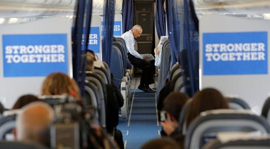 podesta-seated-on-plane